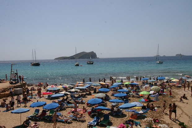 photo of people on the beach in Ibiza, Spain.